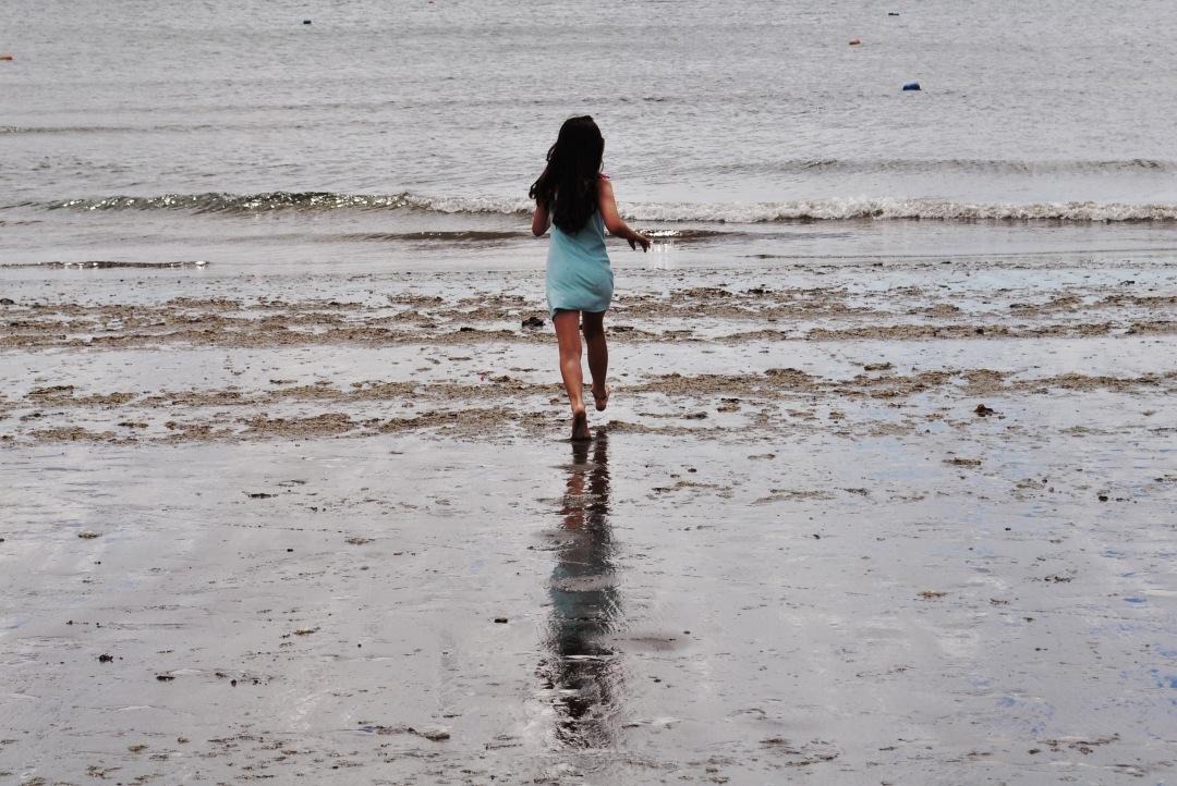 stock photos free  of girl walking on the beach Valdes Peninsula