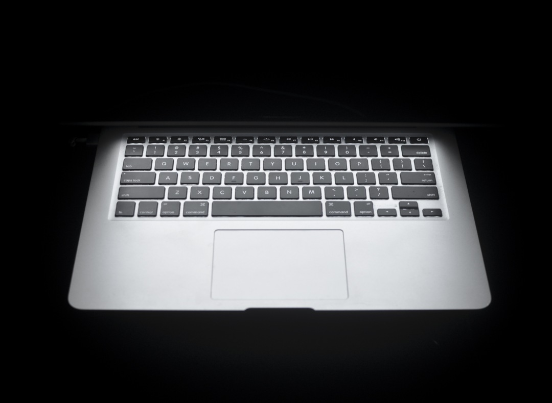 stock photos free  of frontal macbook air on black background