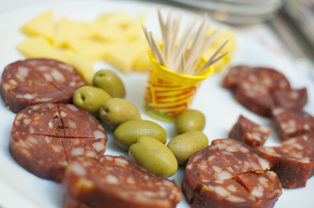 stock photos free  of Italian snack salami with olives and herbs
