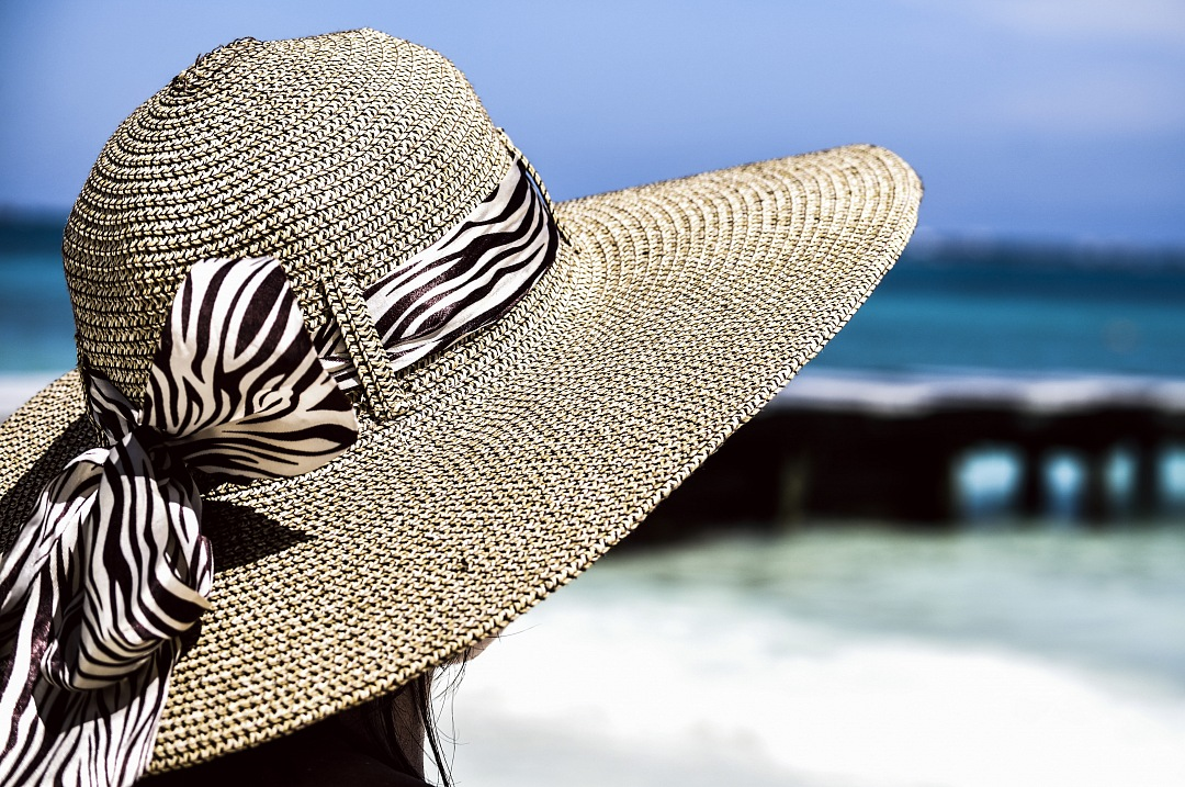 stock photos free  of girl with hat on caribean beach