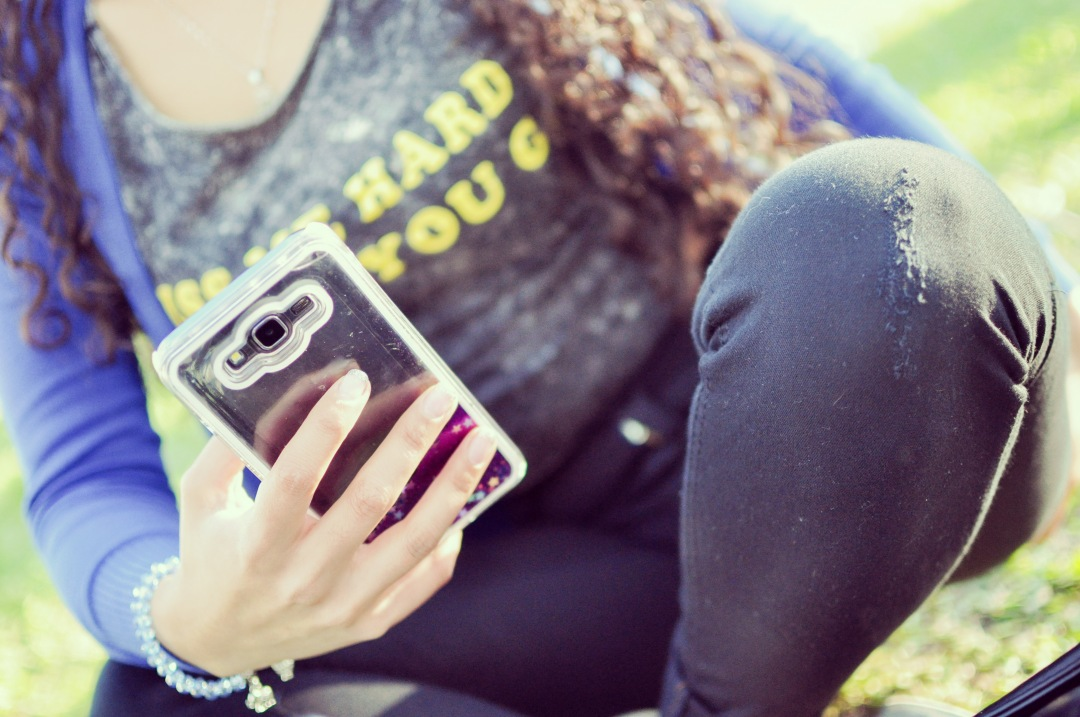 stock photos free  of Woman with smartphone on green park