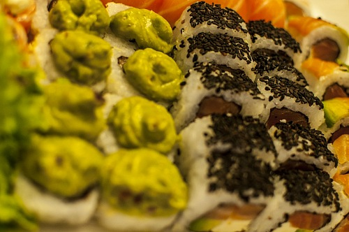 plate with wasabi and sesame sushi variety