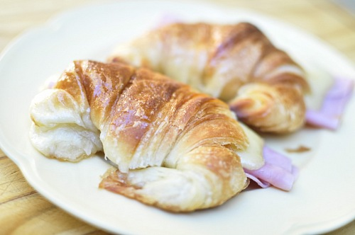 photo Fresh croissants with ham and cheese on plate Medialunas free for commercial use images