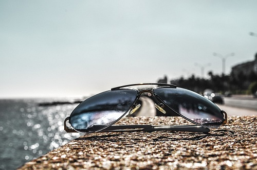 closeup of sunglasses on a wall