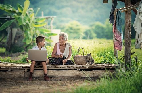 Grandmother with her grandson outdoors