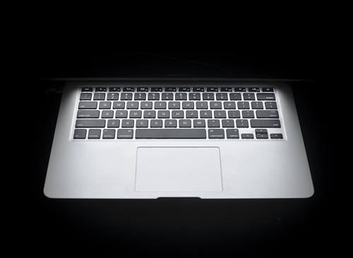 frontal macbook air on black background