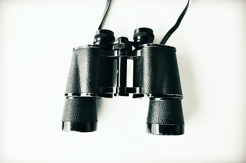 vintage binoculars over white background