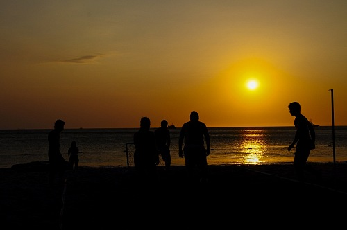 Amateurs playing football at Jumeira beach in Santa Marta, Colombia during sunset.
