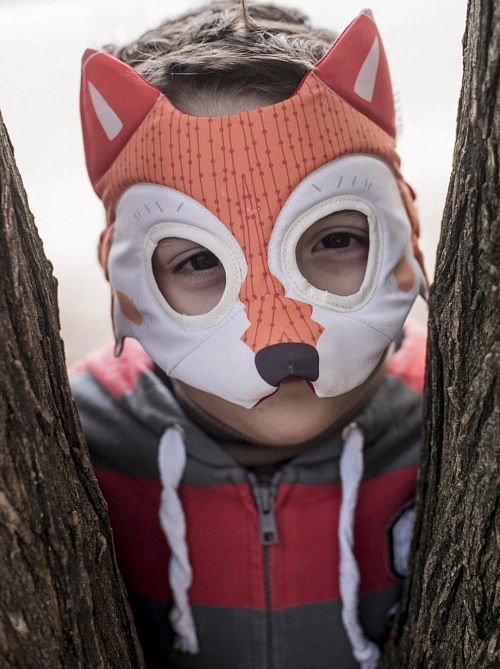 Child with fox costume Playing