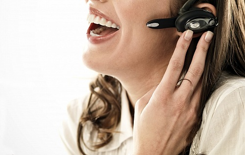 Telemarketing woman smiling