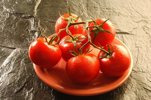 bunches of red tomatoes on a plate